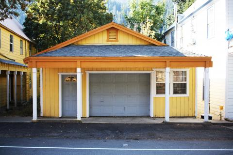 Yellow house with garage