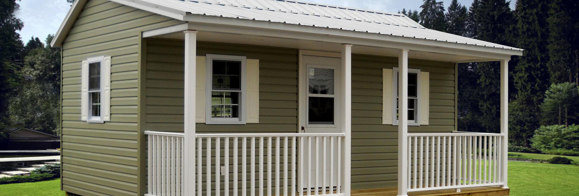 Vinyl side porch cabin in green with white trim
