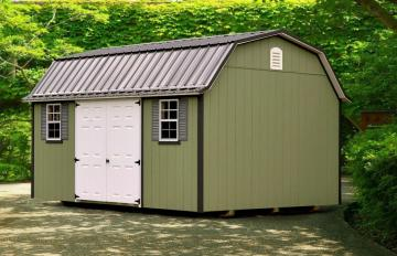 Green garden shed with 12 by 16 dimensions and LP Smart Siding placed on concrete in shaded backyard