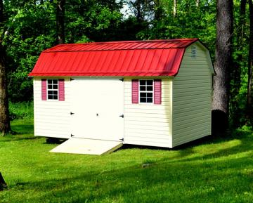 Vinyl sided garden barn with a metal roof