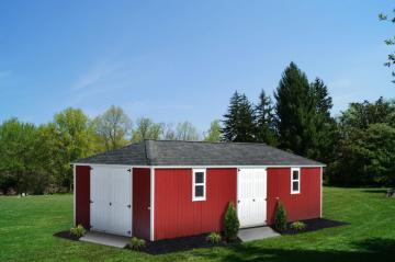 A painted smart siding hip roof pictured in mountain red.