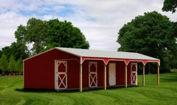 Deluxe horse barn with four foot overhang on front.