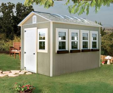 Deluxe greenhouse with green siding and a driftwood shingle roof