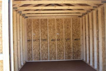 Inside perspective of a painted utility shed with wooden beam construction throughout