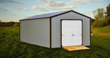 White storage building with double doors and brown trim detail located in green pasture under blue skies and clouds