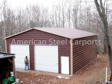 Steel 2-car garage with white doors