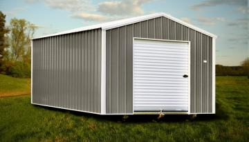 Raber's economy 12x20 storage shed pictured in residential backyard with grass and vegetation