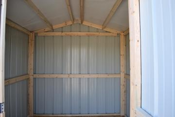 Interior viewpoint of a Raber economy storage shed with grade metal