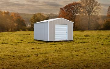 Raber's Portable Storage Barns' standard metal building option with an autumn wooded landscape backdrop