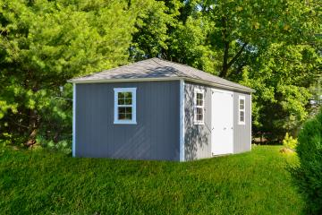 Hip roof shed in gray with white trim