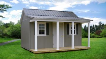 Gray vinyl side porch cabin with white trim
